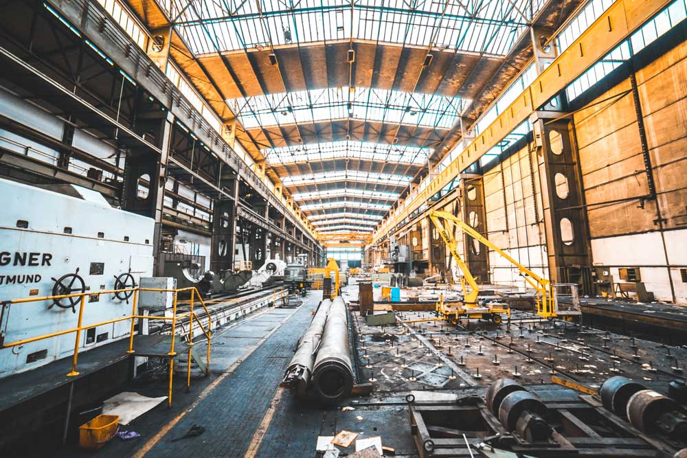 industrial construction site with heavy pipes and equipment